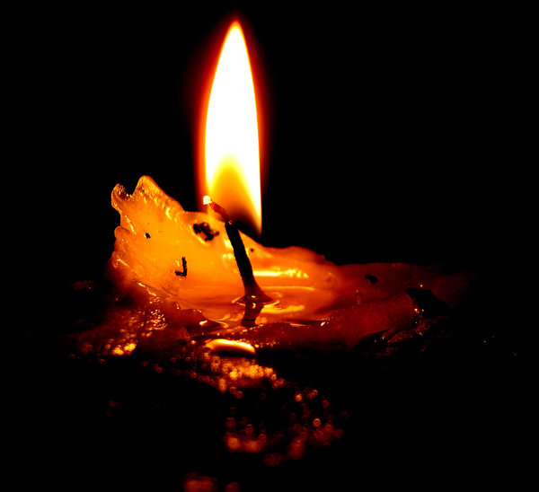 Image result for lighted candle in darkness